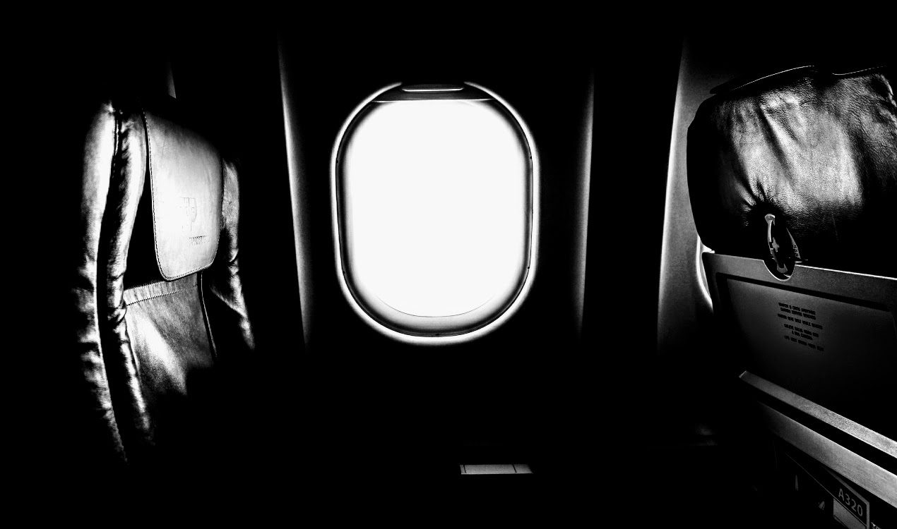 black and white airplane seat
