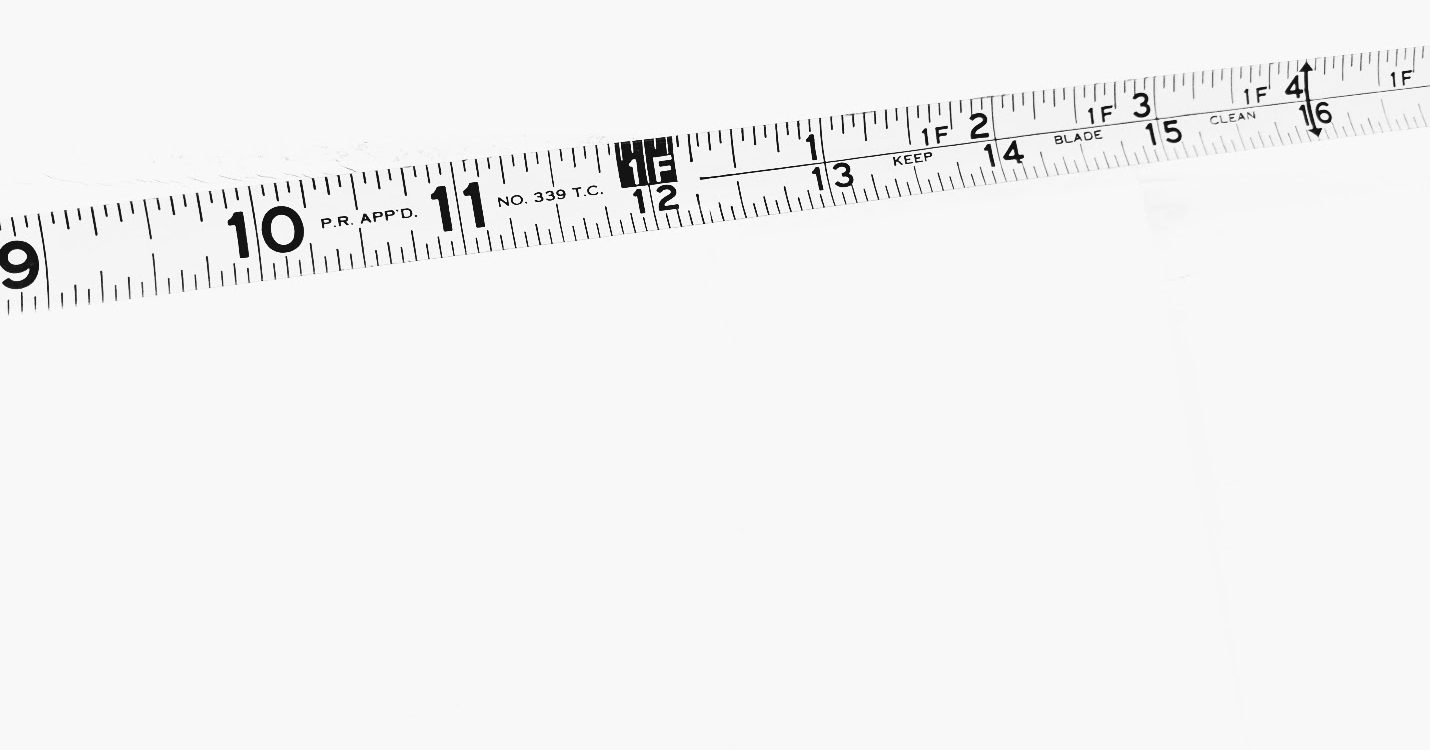 tape measure extended across white background
