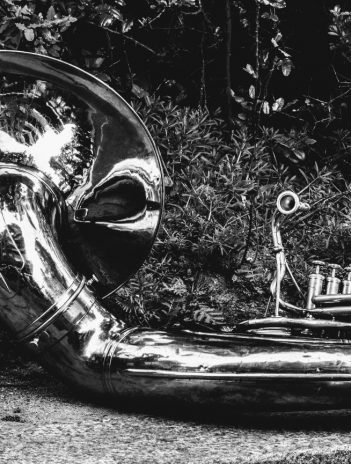 tuba on sidewalk