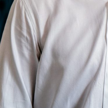 man's white dress shirt with buttons