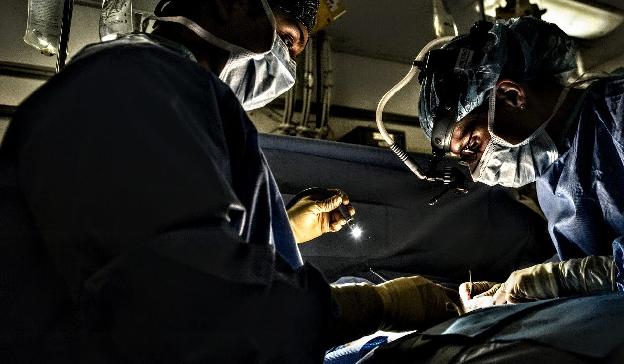 Surgeons working in an operating room.