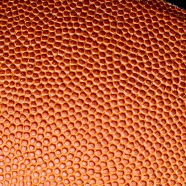 close view shows pebbling on a basketball
