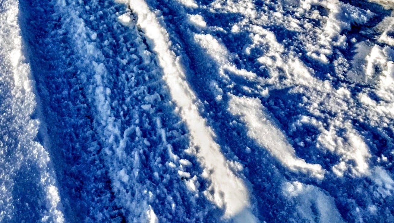 car tire tracks in the snow