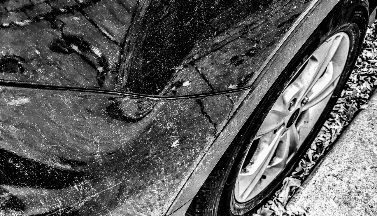 black car close view of front tire