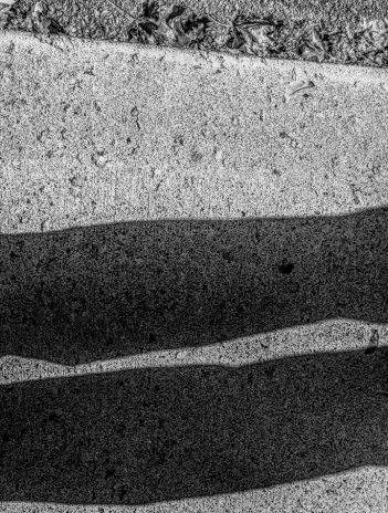 man's shadow on sidewalk