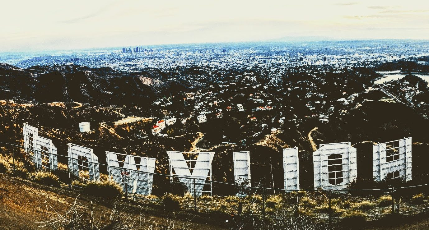 iconic Hollywood sign in reverse as seen from behind