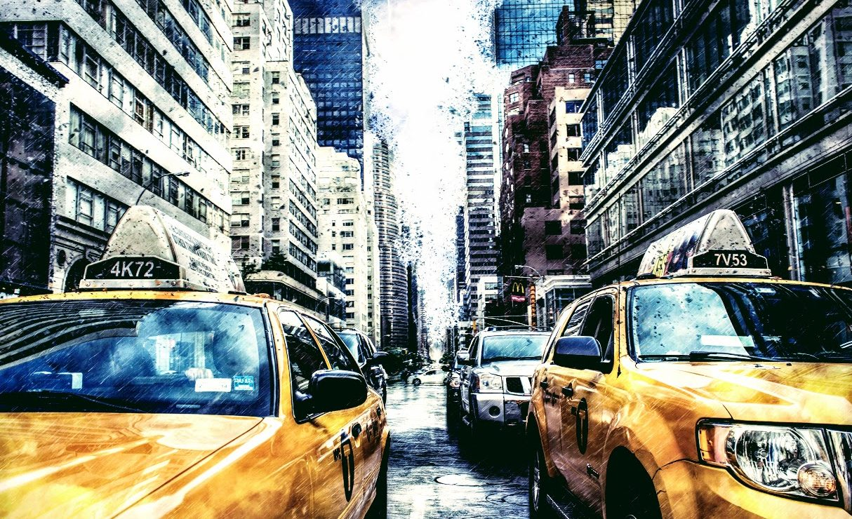 yellow taxi cabs in rainy city street