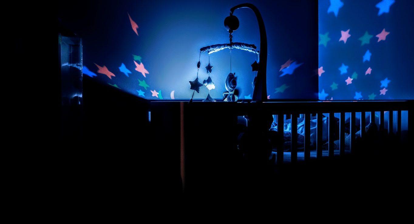 baby crib in dark bedroom