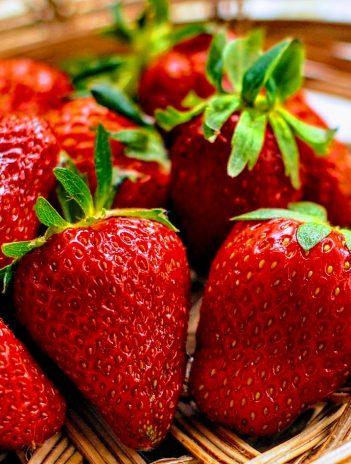 red strawberries in a wicker basket