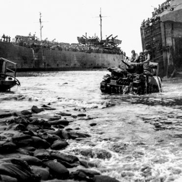 tanks roll ashore from landing ship at Luzon