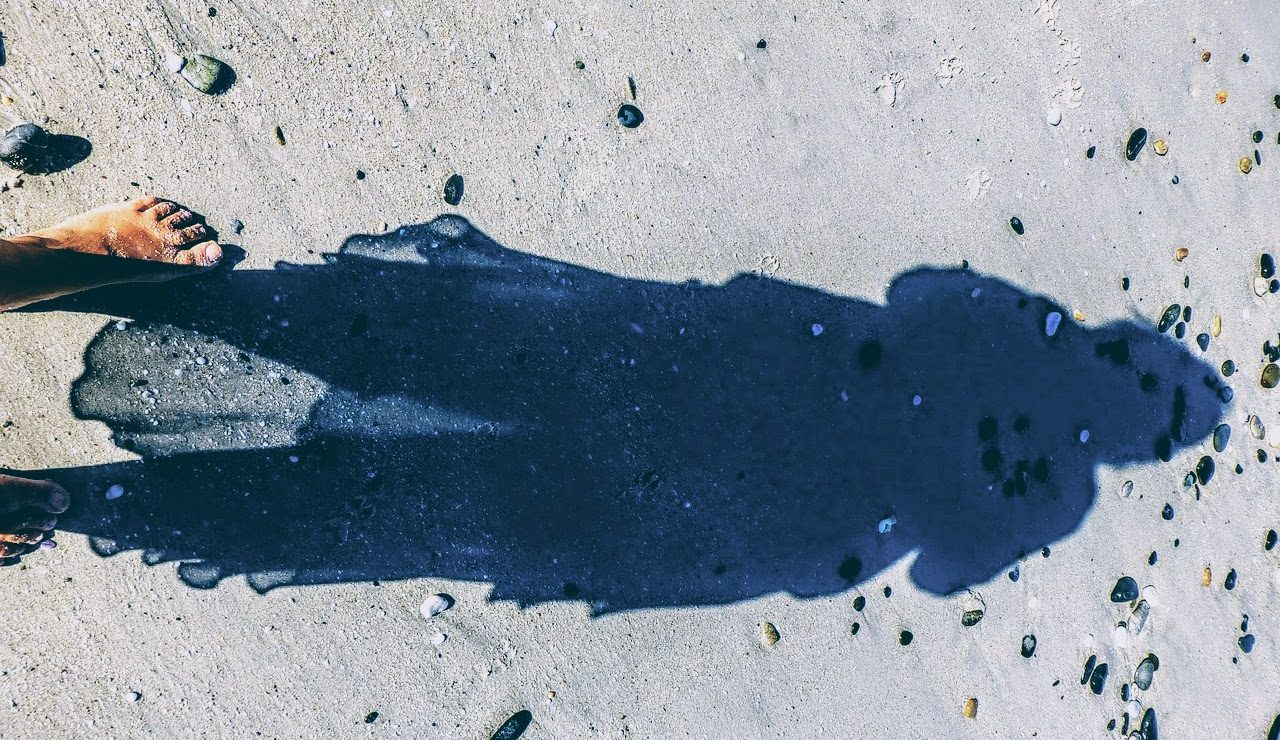 woman's shadow on ground