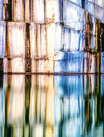 beautiful granite rock wall reflecting in lake